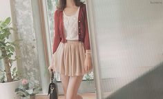 The white blouse looks really pretty with the flesh toned skirt, and the red cardigan gives the outfit a nice touch.