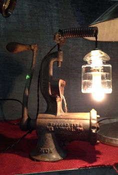 Industrial Lamp, antique meat grinder with glass insulator. Swivels!