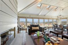 Large windows and skylights welcome natural light into the public rooms. Photo: OpenHomesPhotography.com