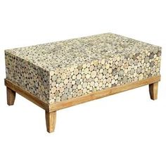 Teak wood coffee table in natural with a weathered base.  Product: Coffee tableConstruction Material: Teak woodColor: NaturalDimensions: 24 H x 39 W x 16 DCleaning and Care: Remove dust with a soft, lint free cloth