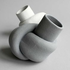 The shape of theses vases by designers Judith van den Boom and Sharon Geschiere was derived from knotted rubber tubing.