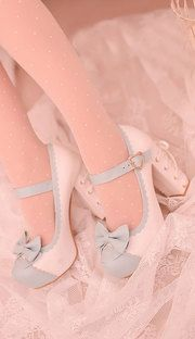 Sweet white and blue bow heeled shoes