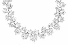 AN IMPORTANT DIAMOND NECKLACE, BY HARRY WINSTON Designed as a graduated series of circular and pear-shaped diamond florets, to the undulating circular and marquise-cut diamond line, mounted in platinum, 1968, 19¾ ins., may be also be worn as a choker necklace and bracelet of 13 and 6¾ ins. resepctively Signed H.W. for Harry Winston, no. 31829