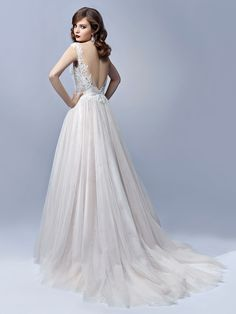 Dreamy fairytale elegance is made extra romantic with an illusion, deep sweetheart neckline on this full-length, A-line gown. The softest, multilayered tulle skirt gives BT17-10 the loveliest flowing look - breezy, beautiful, and full of movement. A sequined,
