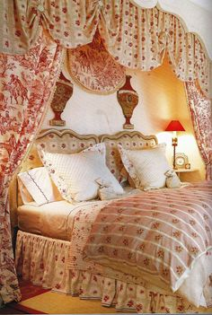 Bed with red toile fabric- a little too frilly but comfy looking.