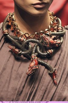 Gold serpents...I can see a villain pulling this off (or a crazed zealot)