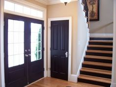 Black Interior Doors - love the black with the risers on the stairs to match. This would totally cut down on shoe marks on the stairs. - March 09 2019 at Black Interior Doors, Black Doors, Interior Paint, Luxury Interior, Custom Wood Doors, Wooden Doors, Black Stairs, Interiores Design, Style At Home