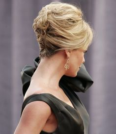 Tip: If you want to keep a look like Charlize Theron's in place all night, keep a travel-size hairspray in your clutch. - GoodHousekeeping.com