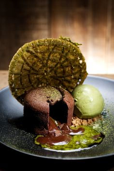 An Extraordinary Dessert: Green Tea Lava at Spot Dessert Bar - The cake's exterior is layered in rich dark chocolate, while a mix of green tea chocolate lava melts inside, topped with a side of fresh green tea ice cream.  Spot Dessert Bar was rated Top 5 Best Desserts in NYC by New York Smash