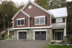Faux wood garage door Model 9700 with Lexington panel design and gray stained finish color and featuring 12 windows arched. This garage door color compliments this home so well.
