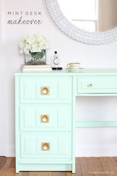 Come see how this old wood desk got a fun mint-colored makeover!