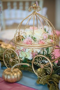 Floral Arrangement inside a Mini Carriage from a Princess Cinderella Themed Birthday Party via Kara's Party Ideas
