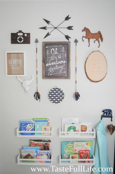 Eclectic Gallery Wall in a Explorer/Adventure-themed Nursery - love the DIY arrows!