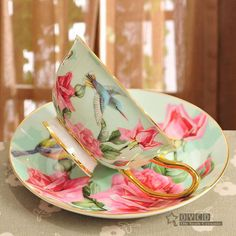 Green (with pink flowers) tea cup and saucer. cAUD via AliExpress. Coffee Cups And Saucers, Cup And Saucer Set, Tea Cup Saucer, Tea Cups, Flower Tea, Rose Tea, My Cup Of Tea, Vintage Tea, Bone China