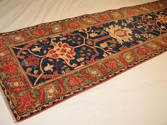 """This elegant hand knotted pile rug is made using natural dyes and handspun wool. This is one of our """"antique revival"""" carpets; carpets that have the look and feel of antique rugs with none of the wear-and-tear. This rug matches and even surpasses the quality of the fine rugs woven over 100 years ago. Made…"""
