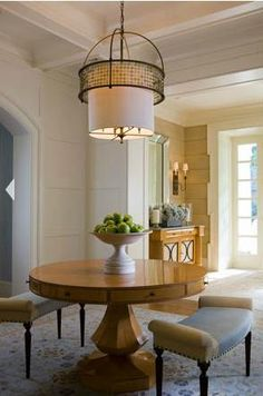 Thomas Pheasant--two-toned benches with lovely round table, interesting wall treatment