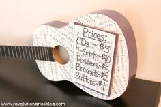 Use an old guitar to display a price list!