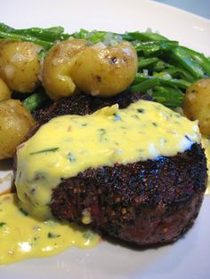 Filet mignon with bernaise sauce, green beans, potatoes and shallots