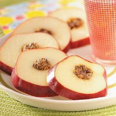 Apple Cartwheels ~ Stuff apples with a yummy filling, then slice the fruit into rings to make eye-appealing after-school snacks. The filling is an irresistible combination of creamy peanut butter, sweet honey, miniature chocolate chips and raisins.