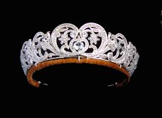 The Spencer Tiara - gold in the form of stylized flowers decorated in diamonds in silver settings. The central element was a gift from Lady Sarah Spencer to Cynthia, Viscountess Althorpe as a wedding gift in 1919. It was later remounted. Four other elements were made to match in 1937. Only the two elements at the end are old and are said to have come from a tiara owned by Viscountess Montagu and left to Lady Sarah Spencer in 1875. Lady Diana Spencer wore it when she married the Prince of…