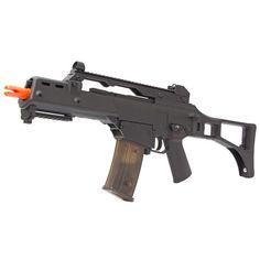 Rifle de Airsoft AEG Elétrico G36C CM011 - Cyma 360 FPS - Preto Ref.:BJH-0272-006-01  Especificações: . - Corpo: Polímero e Fibra de Vidro. - Velocidade: 360 ~ 380fps 109m/s com BBs 0,20g. - Magazine High-Cap em polímero com capacidade para 470 BBs. - Peso: 2,480 Ar15, G36c, Rifle, Airsoft Guns, Weapons, Fiber, Black, Military, Accessories