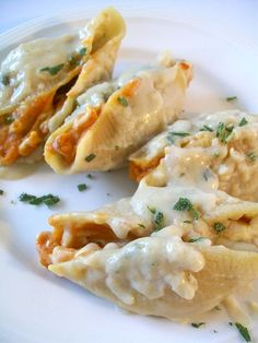 Pumpkin-stuffed pasta shells with a sage-Alfredo sauce. Creamy, delicious, really easy and so perfect for fall!