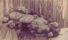 "Very common for the child to be completely surrounded by flowers as they lay in the ""death room"" of Victorian homes."