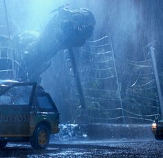 "So famous plot hole: Why is the T. rex on flat terrain when it breaks through the fence, but when it pushes the car over the edge, there's a huge hundred-foot crevasse? | 15 Questions ""Jurassic Park"" Left Unanswered"