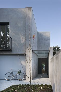 Behind an unassuming façade, Robson Rak's Courtyard House reveals a pared-back modern design mixed with luxurious materials and practical detailing.
