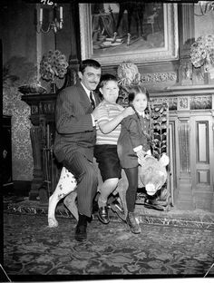 John Astin, Ken Weatherwax, and Lisa Loring in The Addams Family.
