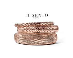 Rose Gold plating brings color to Ti Sento's signature Sterling Silver. These bangles with a structure of pave set stones are easy to wear! Would you wear the big, middle or small one? Available at Daniel Jewelers, Brewster New York