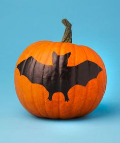 Pumpkin with painted bat to avoid cutting & carving!
