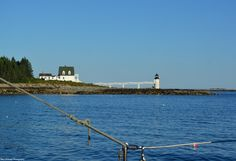 The Marshall Point Lighthouse, as seen while heading southwest from Port Clyde on the Mohegan Boat Line's vessel, the Laura B, for the Friday evening Sunset Cruise. The photographs that follow are out of sequence, as the preceding photos from the last day of July 2015 showed the sunset and full blue moon's rising. These next bunch of pictures were taken prior to those events, on the way out to Eastern Egg Rock and beyond