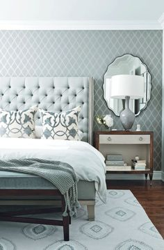 Mirrors above nightstand, upholstered headboard