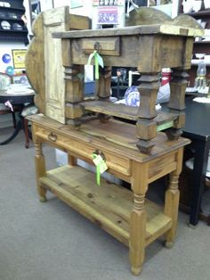 $145 - We currently have a Mexican Pine sofa table with a single long drawer and iron hardware. The sofa table has a lower shelf for additional display. It measures 47 inches across the front, 17 inches deep and it stands 29 inches tall, priced at $145. We also have pictured to Mexican Pine side tables. Heavily carved legs, a single drawer and the top made from a cabinet door. These small tables are sold individually for $99 each. These tables can be seen in booth A 6 at Main S...
