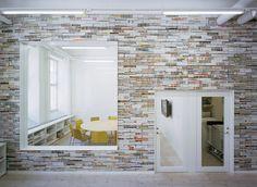 Interior wall made from stacked magazines (Sweden). Nice photo gallery. Oktavilla / Elding Oscarson