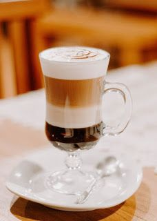 Clear Footed Drinking Glass Filled With Cappuccino on White Ceramic Saucer and Table · Free Stock Photo Coffee Type, Coffee Art, Coffee Music, Espresso Drinks, Coffee Drinks, Mini Desserts, K Cup Coffee Maker, Coffee With Alcohol, Decaf Coffee
