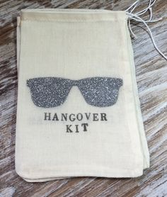 """These 4x6 inch (10x15cm) cotton drawstring bags are hand stamped with silver glitter sunglasses and """"Hangover Kit."""" Perfect for a bachelorette party or bridesmaid gift! Throw them in your welcome bags"""