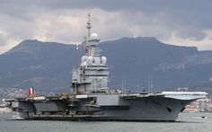 The largest aircraft carrier currently in service with a European navy is the 40,000 ton Charles de Gaulle. The nuclear-powered ship is the French navy's flagship.