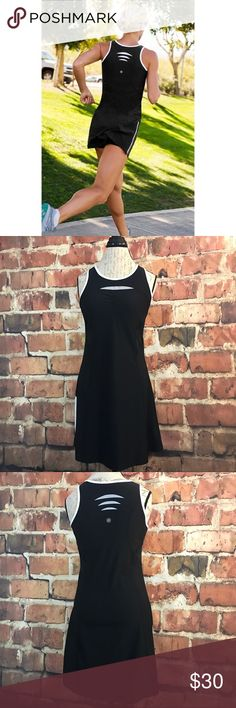 """Athleta Smash Dress Reflective & Mesh Sleeveless M A black tennis dress from Athleta featuring a side zipper, & reflective areas as pictured, ideal for a workout day. Size M.    Additional Information:  Made in: China  Material: (Shell: 90% polyester/10% spandex, Bra liner: 92% polyester/8% spandex)  Bust: 35""""  Waist: 33""""  Length: 32"""" Athleta Dresses Mini"""