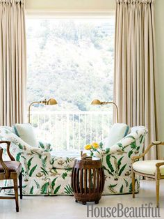 A tête-à-tête covered in a discontinued fern print from Schumacher is a perfect spot in the guesthouse.
