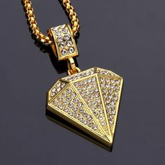 Get yourself this DOPE Gold Diamond Rhinstone Hiphop Necklace and Pendant! Limited stock, be quick! * This item comes with a gift box * ✖️ These normally sell for $129.95 US ✖️ ✔ JUST $79.95 Necklace