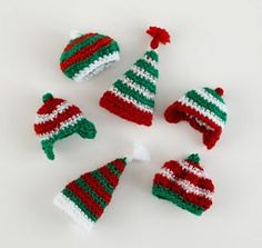 Wee Winter Hat Ornaments pattern by Lion Brand Yarn Little Hats can be used as holiday ornaments for your tree, or as egg cozies or doll hats. Christmas Tree Hat, Crochet Christmas Ornaments, Christmas Crochet Patterns, Holiday Crochet, Christmas Knitting, Holiday Ornaments, Christmas Crafts, Ornaments Making, Crochet Crafts