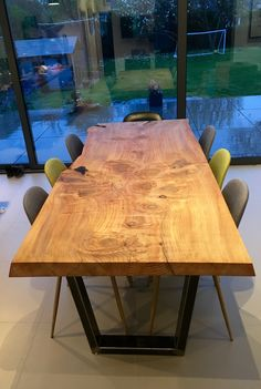 Live edge table, lots of light & space. Nice light play on wet surface outside.