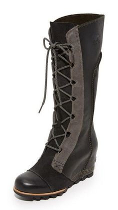 A mix of leather and suede lends subtle texture to sleek Sorel boots. Raised seams accent the shaft. Lace-up closure. Covered wedge heel and rubber sole. Leather: Cowhide. Imported, China. Measurements Heel: 2.5in / 65mm Shaft: 13.5in / 34cm Circumference: 14.25in / 36cm
