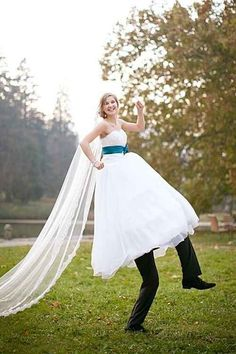 Something a little silly, if you don't mind the groom having his head up your skirt. | 42 Impossibly Fun Wedding Photo Ideas You'll Want To Steal funny wedding pics, dream wedding dresses, bridal pose, funny wedding photos, photo idea, wedding pictures, groom, wedding fun, short dresses