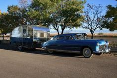 vintage car towing a same tone vintage travel trailer-looks good
