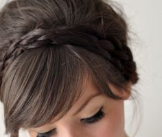 Braid, bangs and a simple updo. Wish my hands weren't so tarded so I could try and pull something like this off!