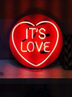 'It's love' Neon, 2013 by artist Chris Bracey