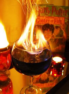 Harry Potter drink!!! The Goblet of Fire: vodka, blue curacao, lemonade, and a splash of 151- light it on fire & add cinnamon to make the flames spark. Ridiculous grin on my face right now.